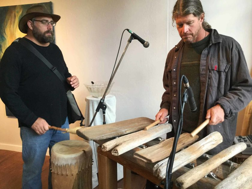 Two men playing the marimbas and djembe